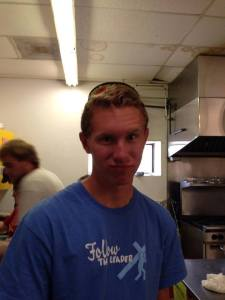 Adam Pugh in the kitchen on a mission trip to Montana.