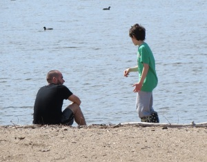 Father and son at lake